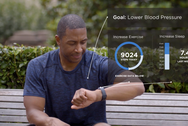 black man looking at watch with animated chart overlay