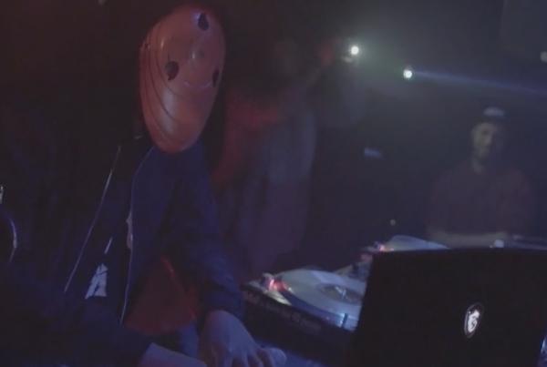 dj wearing mask playing in club